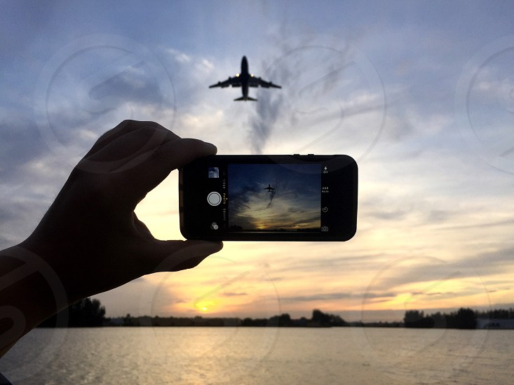person taking a photo of plane while on air photo