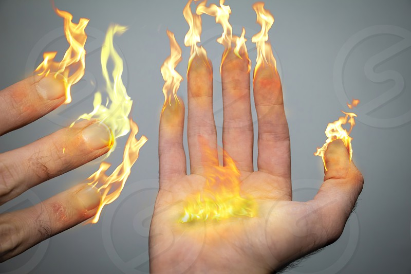 Right hand and fingers are on fire like candles or torches. Being an inspiration of the Hanukiah (menorah). 8 fingers symbolizing the menorah candles and a big flame in the middle of the palm symbolizes the Hshamash.