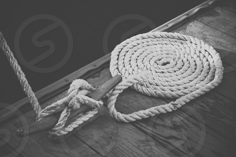 white rope wrapped around cleat photo