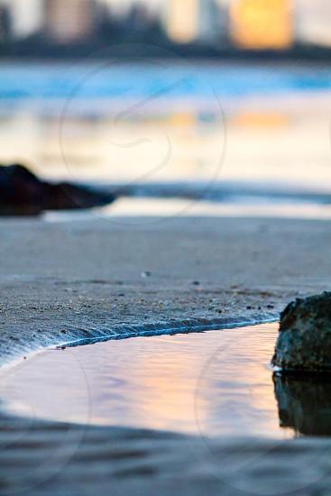 Beach puddle rock sand photo