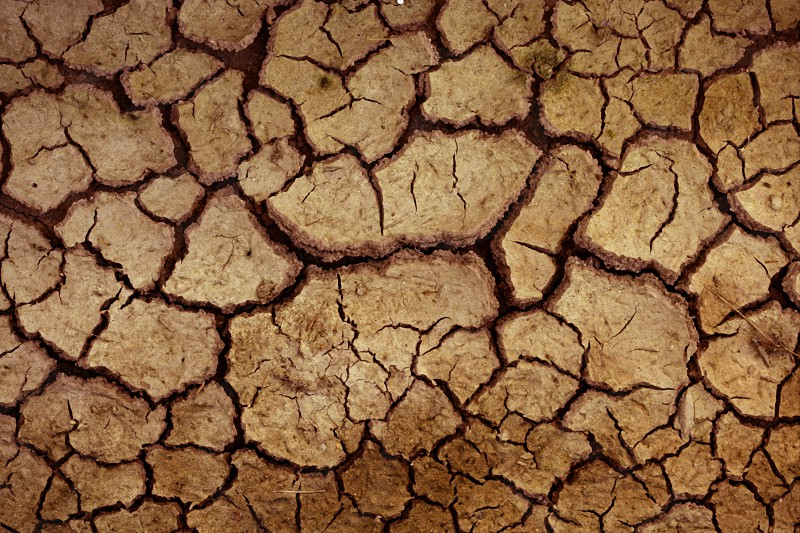 Dry red clay soil texture natural floor background photo