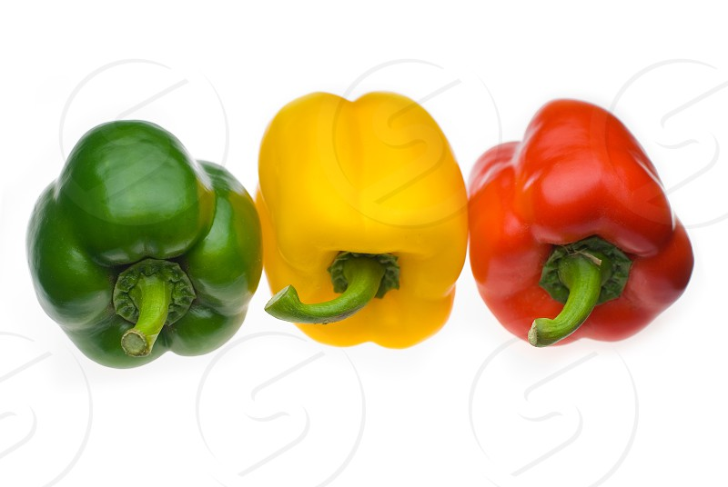 fresh colorfull bell peppers isolated over white background photo