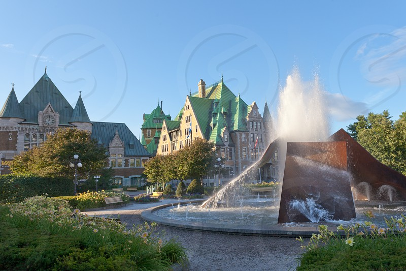 Fountain in front of historic building landmark of Gare du Palais railway station in Quebec City Canada photo