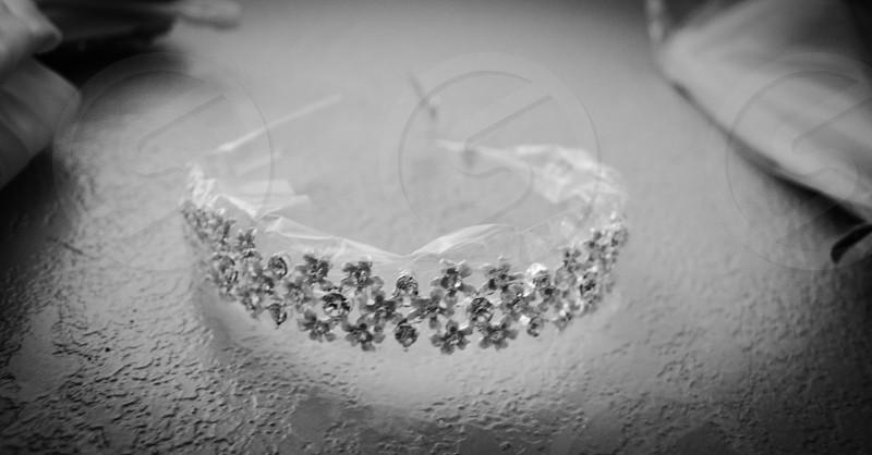 grayscale photography of diamond encrusted alice band photo