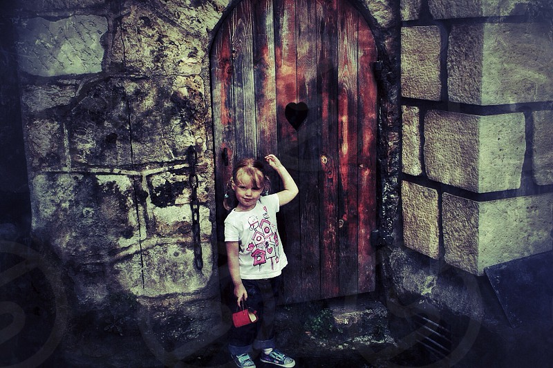 Architecture door wooden child girl stone wall france village photo