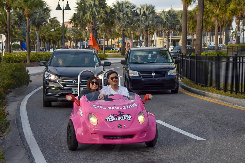 Clearwater Beach Florida. January 25 2019 Family enjoying pink scoot coupe close to Piere 60 area in Gulf Coast Beaches (2) photo