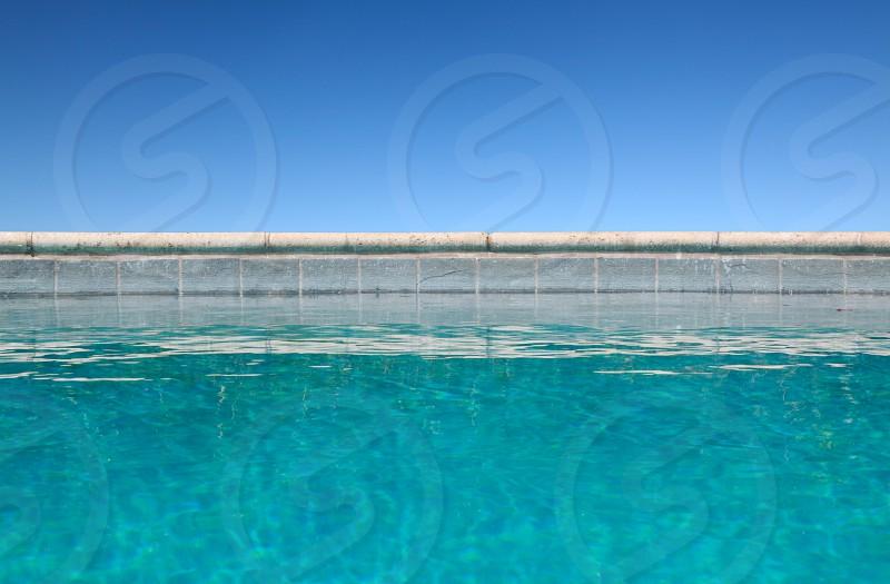 Pool edge w/sky in background photo