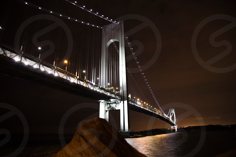 low light photography of a bridge with white lights during nighttime photo