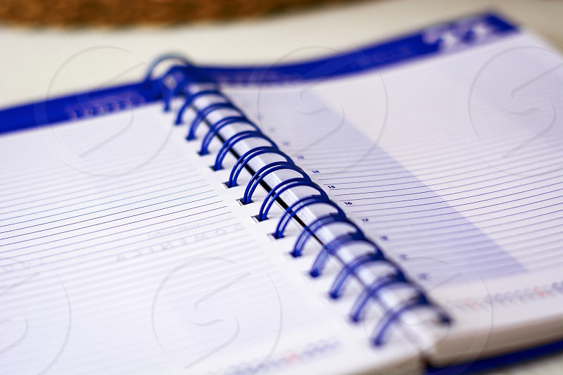 Open spiral notebook with lined sheets to write important appointments of the day. Business and productivity concept. Stationery object. photo