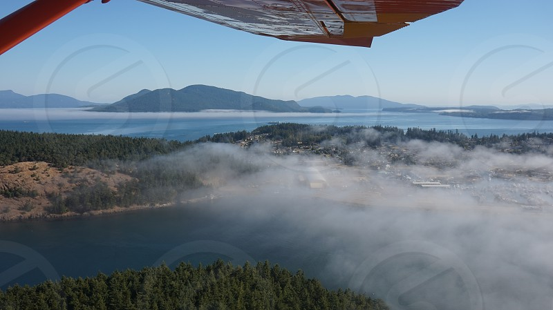 aerial view of clouds across mountain photo