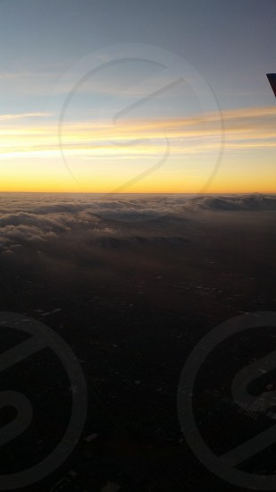 Picture of Morning Clouds coming by my plane to Las Vegas! photo