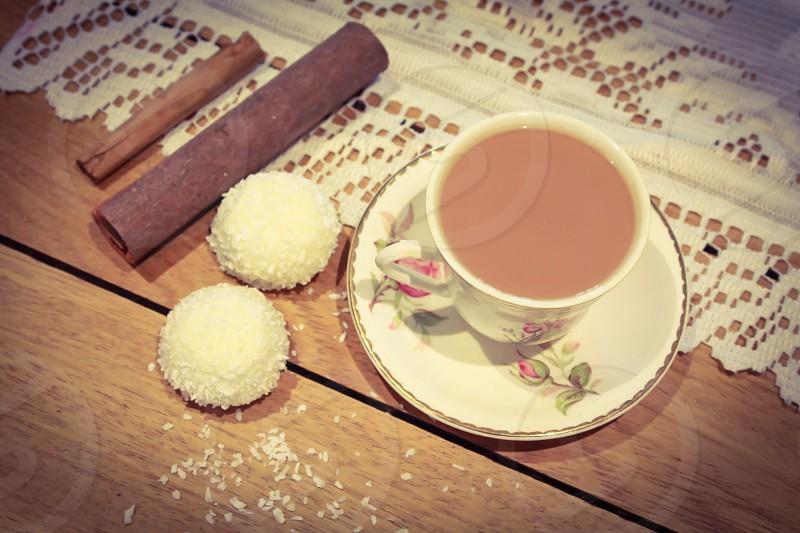 2 white round breads beside white tea cup photo