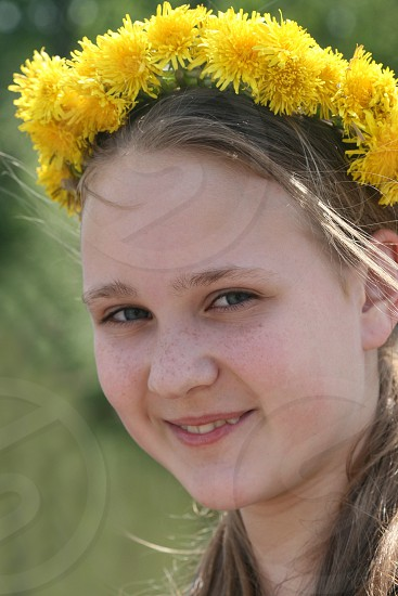 brown hair female with yellow petal flower headdress closeup photo photo