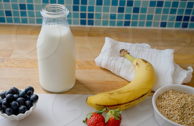 milk breakfast oats blueberries banana strawberries photo
