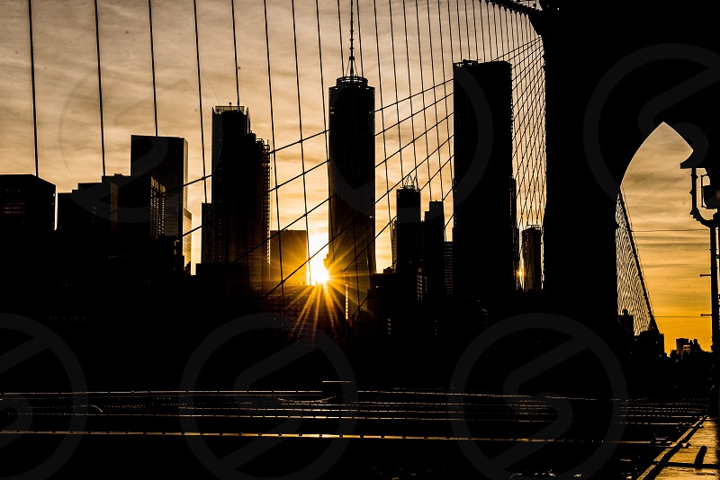 Manhattan view at sunset time  from Brooklyn Bridge.  photo