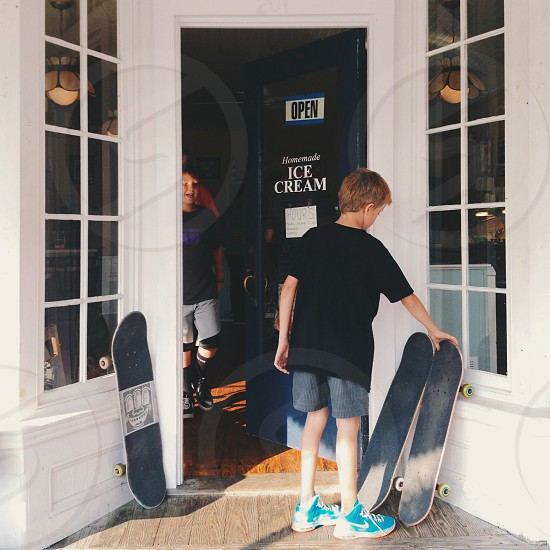 door open shop boy skateboard town ice cream parlor summer teal photo