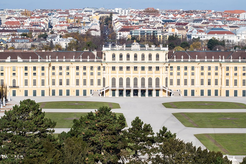 Vienna Austria. Classic view of famous Schonbrunn Palace with Great Parterre garden on sunny day with blue sky and clouds in spring or summer. photo