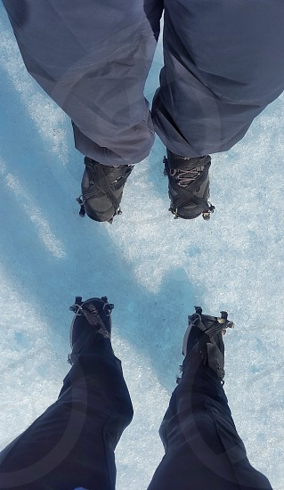 standing on the ice with crampons photo