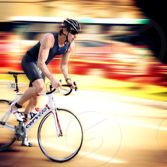 cyclist on bicycle on road photo
