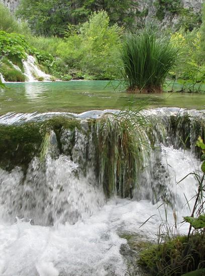 Tropical area of waterfalls greenery vegetation. Croatia photo