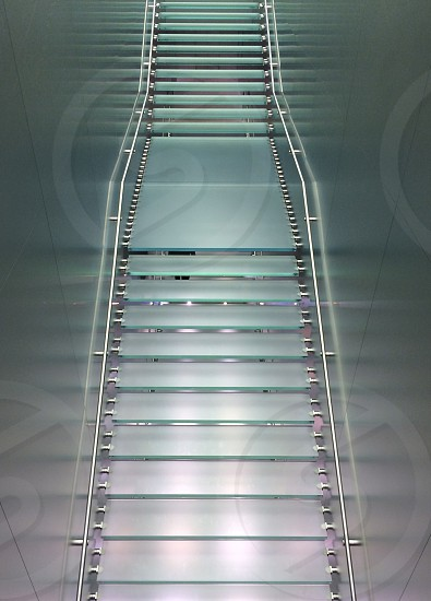 A glass staircase in an Apple store photo