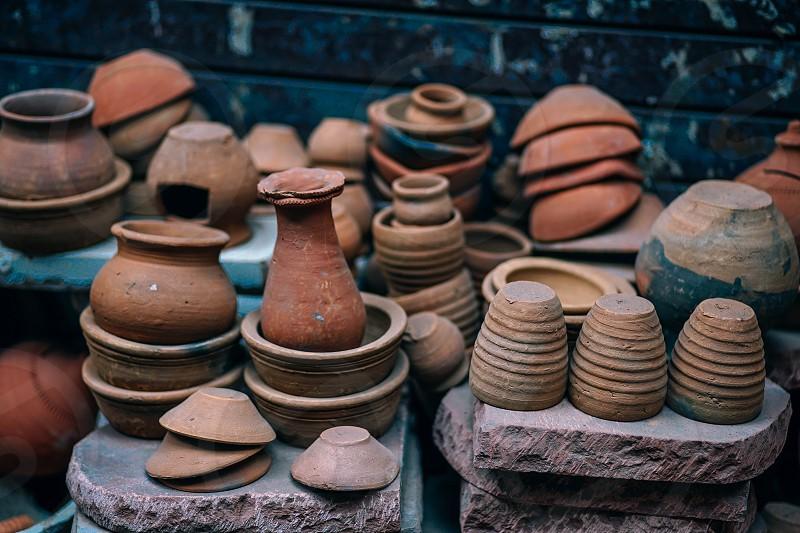 Artistic handmade ceramic clay brown terracotta pots. photo