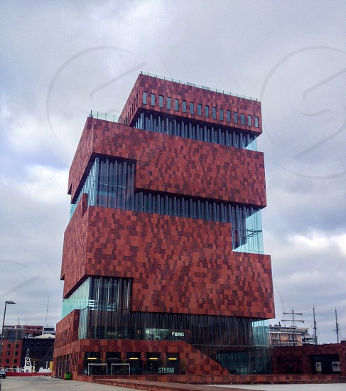 brown and red concrete building under cloudy sky photo