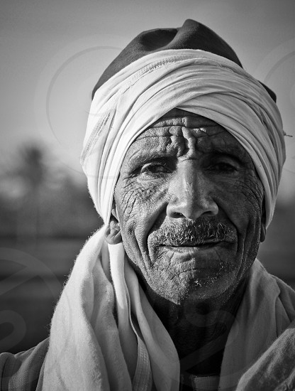 Old man in traditional clothing Egypt photo