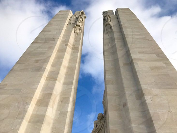 Outdoor day landscape horizontal colour Vimy Ridge France Europe European Battle of Arras Western Front World War One WWI WW1 First World War battleground war warfare trench Trenches memorial remembrance commemoration white marble stone carved Canada Canadian mourning monument sky clouds blue photo