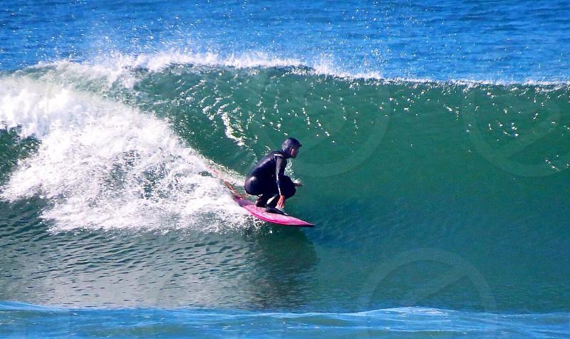 Women Surfer surfing photo