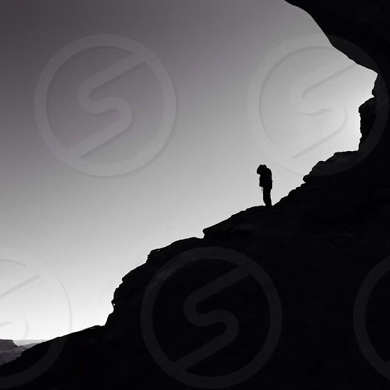 man on rocky mountain silhouette photo