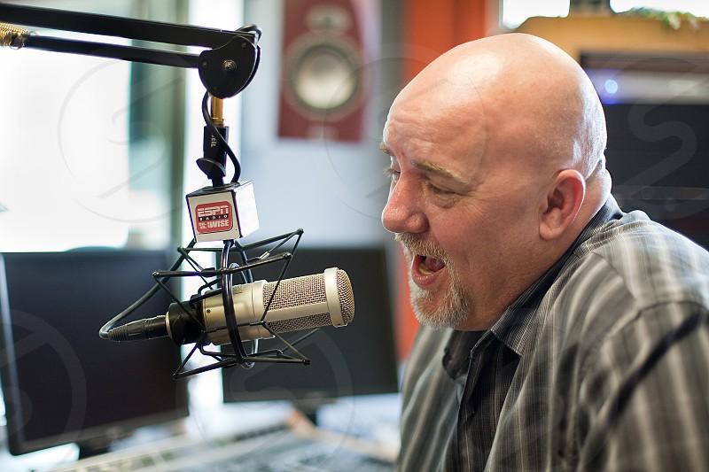 Radio DJ at work on air photo