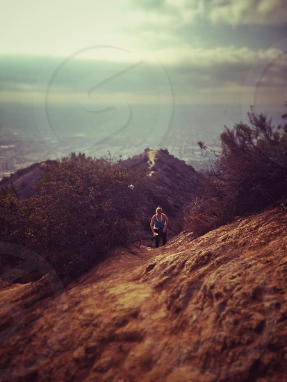 Sporty woman running up a canyon in Los Angeles photo
