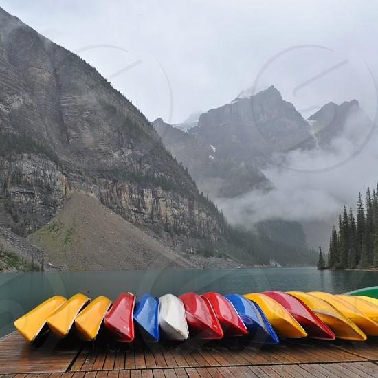 Canoe dock on a mountain lake in Alberta photo