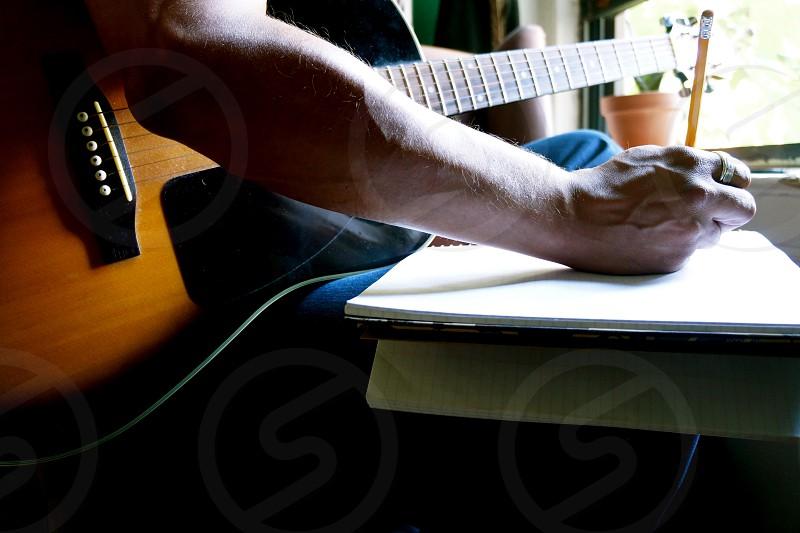 man playing guitar photography photo