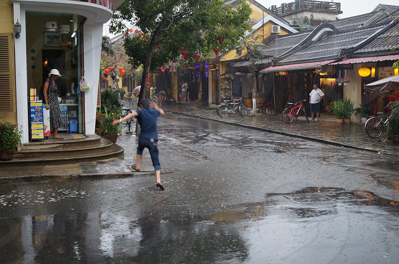 person running on water covered street photo