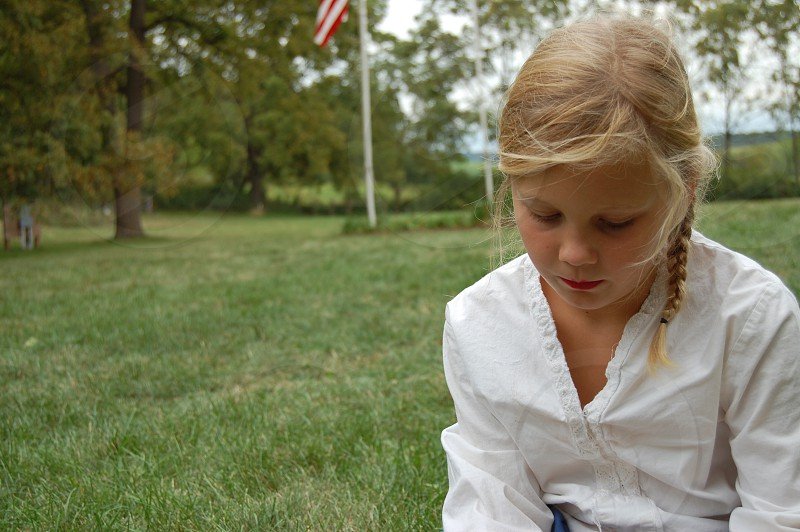thoughtful girl child flag nature peacefulwhite blouse blonde hair photo