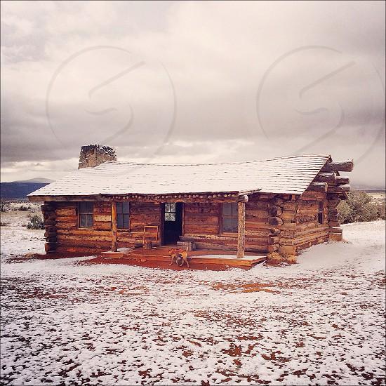 cabin on snowy field  photo