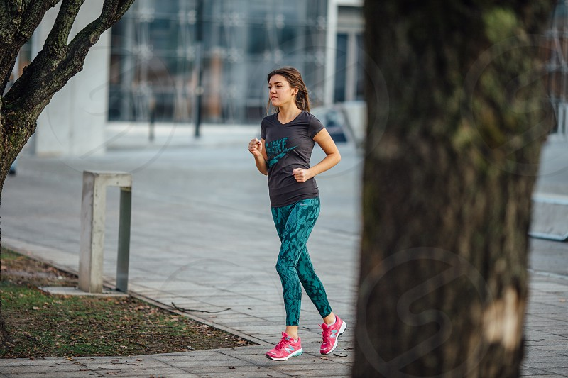 young girl running in the park autumn time. Healthy life style photo