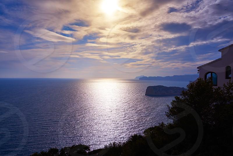 Cap de la Nau Nao cape sunset in Xabia Javea Mediterranean sea of Alicante Spain photo