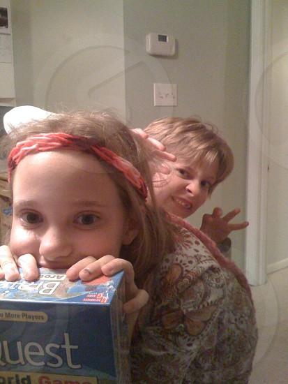 girl with blonde hair wearing orange headband photo