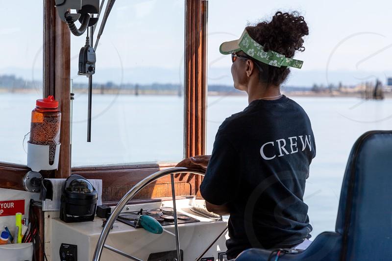 Helmsman steering the Jetty Island Ferry photo