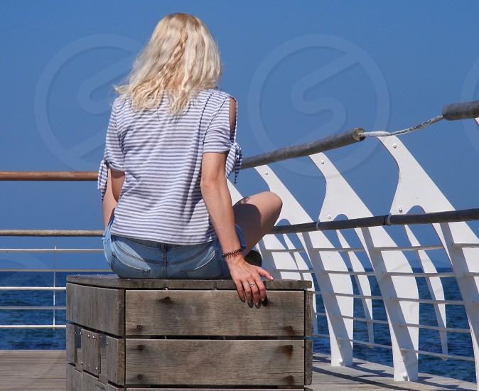 Woman sea summer blonde girl sitting photo