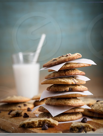 Stack of Homemade Chocolate Chip Cookies and a Glass of Milk photo