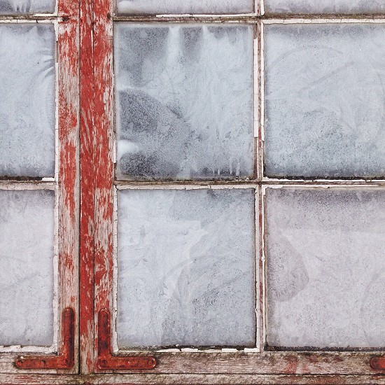 red wooden framed glass window covered with snow photo