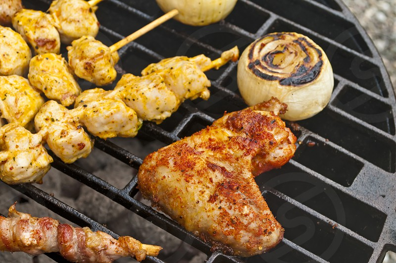 barbecue with meat chicken and onion photo