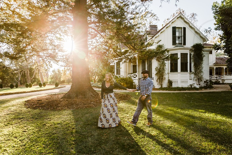 man and woman on green grass photo