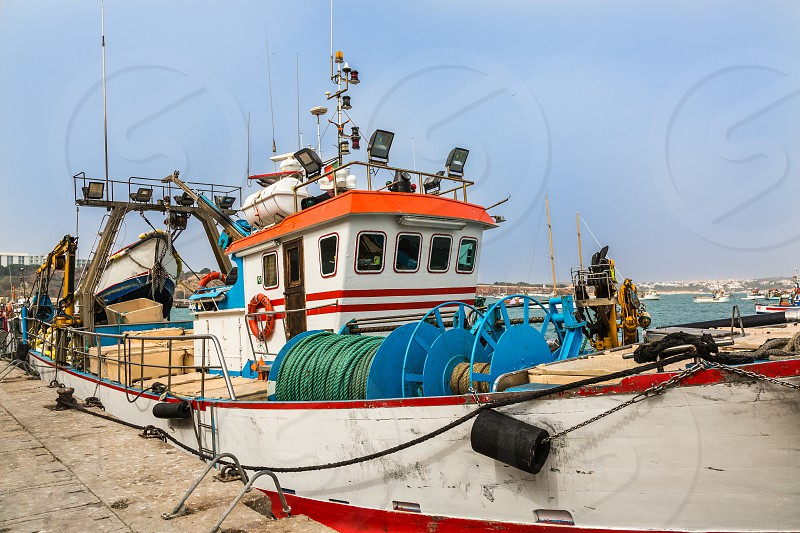 Fishing boats in the port of Sagres in the southwest cape of Europe. Most southwestern Atlantic coast of Portugal. photo