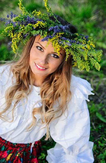 """The folk practices of Sânziene imply that the most beautiful maidens in the village dress in white and spend all day searching for and picking flowers of which one MUST be Galium verum (Lady's bedstraw or Yellow bedstraw) which in Romanian is also named """"Sânziànă"""". Using the flowers they picked during the day the girls braid floral crowns which they wear upon returning to the village at nightfall. photo"""