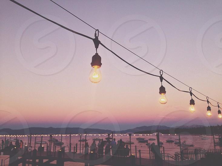 Summer sunset lake lights alpenglow pier dining people cafe photo